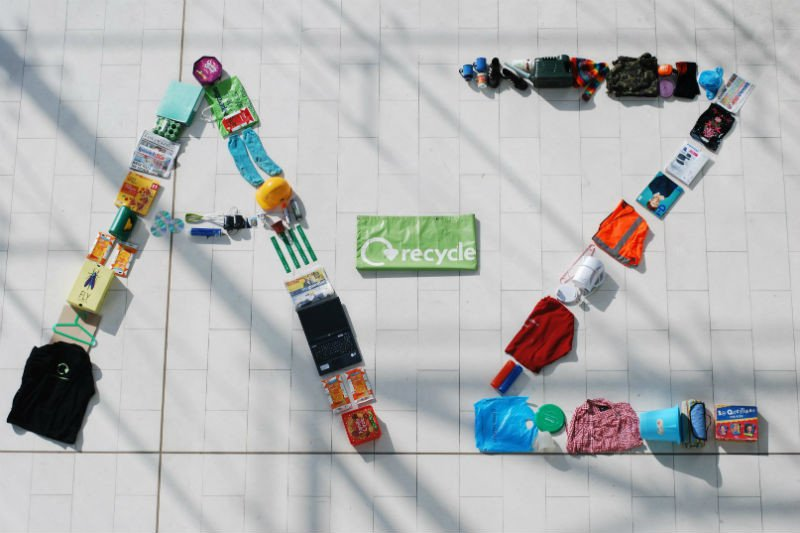 Letters A and Z displayed with recycled items on the ground