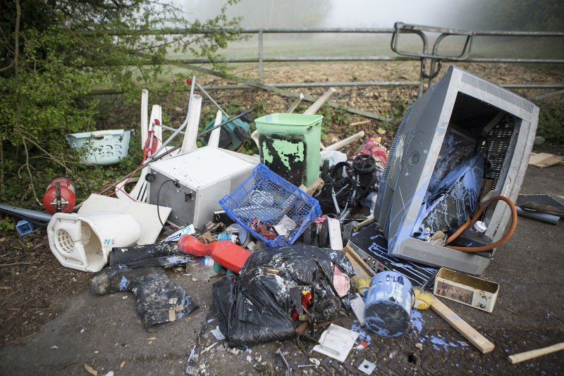 Fly-tipped rubbish on the ground outside